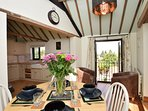 Country style kitchen with beamed ceiling