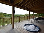 Shared sunken hot tub on the decked area with countryside views