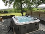 Relax in the hot tub and admire the views