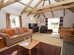 Lounge with French doors leading to decked area and garden