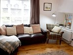 The large sofa and cosy blankets are perfect for snuggling up at the end of the day