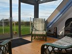 Relax in the mezzanine floor lounge with balcony and wood burner