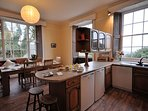 Kitchen with breakfast bar and dining area