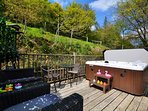 Decked garden with seating and hot tub