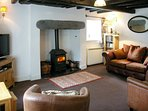 The cosy lounge has large woodburner and beams