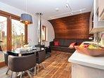 Open-plan lounge/kitchen/diner with woodbuner