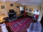 Large sitting room with French doors leading to terrace