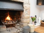Relax by the fire in the snug
