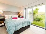 Master bedroom with ensuite shower room and bi-folding doors onto the balcony