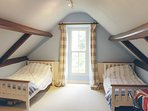 Twin bedroom situated in the eaves