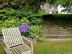 Relax in the pretty lawned gardens