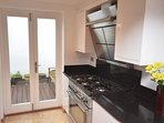 Kitchen with french doors out to the decked area