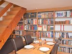Dining room with feature book case