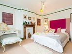 The king-size bedroom includes stylish interior touches and en-suite