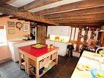 Farmhouse kitchen with traditional Aga