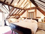 Super-king bedroom with beautiful beams