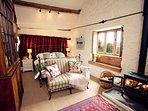 Double bedroom with woodburner