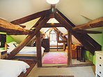 Attic bedroom with three single beds