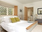 Master bedroom with wonderful leaded glass windows