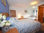 En-suite bedroom with king-size and additional single bed