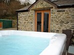 Relax in the private hot tub during your stay
