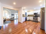 Open floorplan kitchen with modern appliances, gas stove with griddle; bright and airy