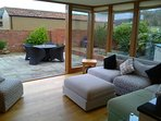The outside in - large windows and doors create a feel of being outside