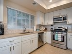 The full kitchen features all new appliances, cookware, and dinnerware.