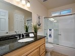 Master bathroom with shower/tub combination.