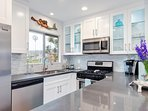 Full kitchen is all new and includes common appliances and dinnerware.