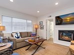 Unit B: Living room with TV, fireplace, and sleeper sofa
