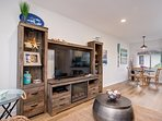 Unit C: Entertainment center with TV and fireplace