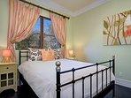 Queen bed in downstairs guest bedroom