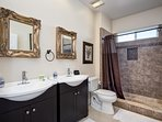 Beautiful master bathroom with double sinks and tiled shower