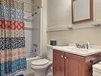 The full bathroom offers a shower/tub combo.