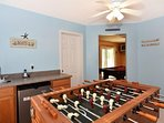Game room with wet bar and foosball table.
