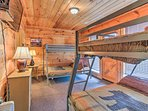 Two twin-over-full bunk beds are in the lower level bedroom.