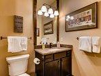Rinse off before bed in this full en-suite bathroom.