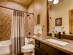 The second bathroom features a tub/shower combo and mirrored vanity.