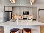For additional seating, utilize the quaint breakfast bar set for 2.