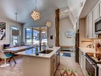 Vaulted ceilings accentuate the open-concept layout.