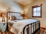 Two can share this second bedroom offering a plush queen bed.
