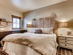 The master bedroom exudes rustic elegance.