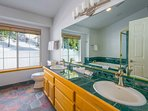 A huge double vanity fills the wall in the Master Bathroom.