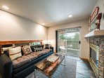 The first-floor entertainment room has a trundle sofa and access to the back patio.