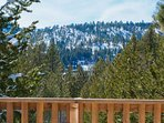 Your back deck has a front-row seat of the ridgelines of South Lake Tahoe.