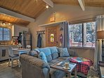 The vaulted knotty pine ceilings really open up the cozy space.