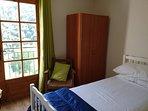 The single bedroom has a Juliette balcony