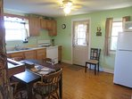 This kitchen is filled with many amenities.