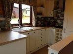 Kitchen - dishwasher, fridge freezer, microwave, toaster, kettle, Grill and Hob